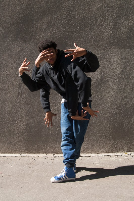 BBoy Monsters Heat - Blind Justice, BBoy Heat doing a toprock pose with 6 arms.