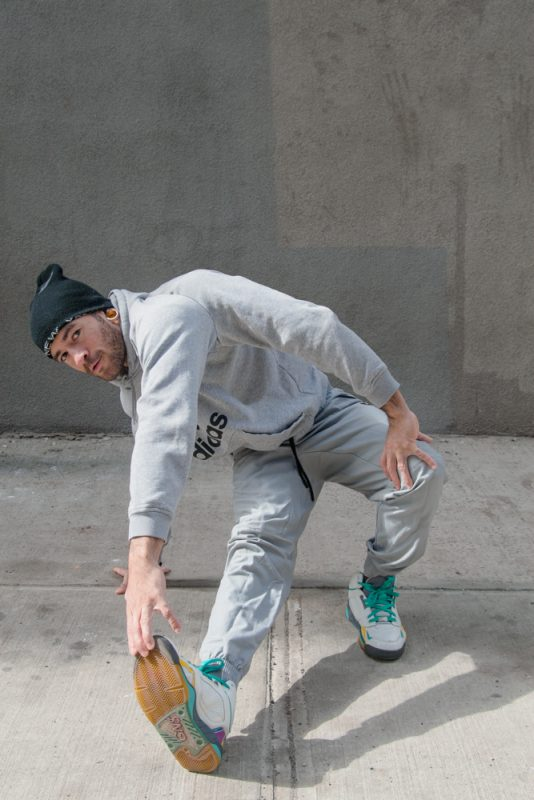 BBoy Monsters - Mike Fresh, Footwork Stretch. BBoy Mike Fresh, doing footwork poses on a sidewalk in Dumbo Brooklyn.