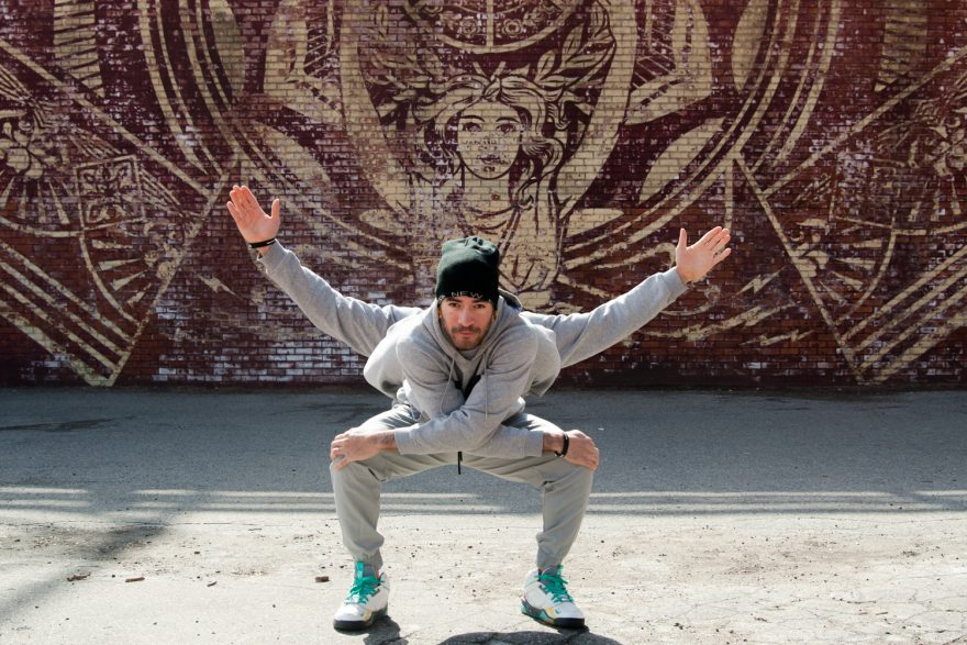 BBoy Monsters - Mike Fresh, Sumo Stance. BBoy Mike Fresh, doing standing poses in front of a Shepard Fairy mural in Dumbo Brooklyn.