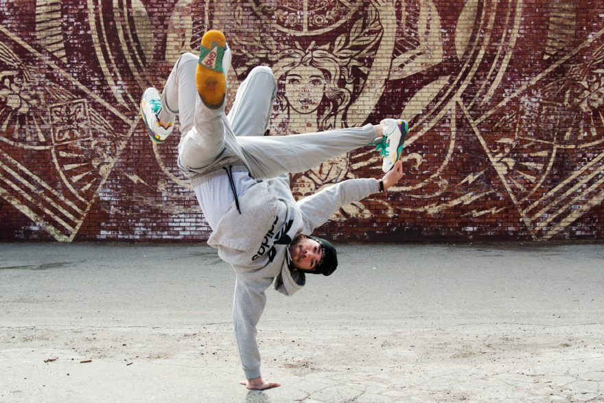 BBoy Monsters - Mike Fresh, Thread Kick. BBoy Mike Fresh, doing air freeze poses in front of a Shepard Fairy mural in Dumbo Brooklyn.