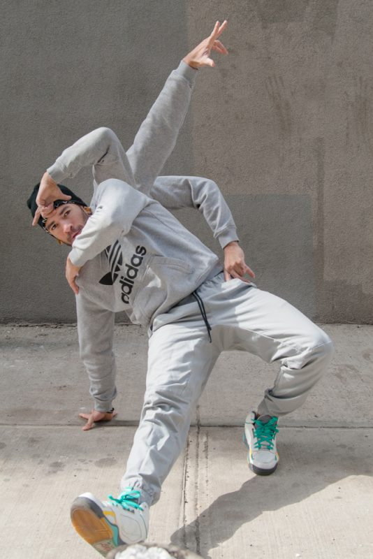 BBoy Monsters - Mike Fresh, Trident. BBoy Mike Fresh, doing footwork poses on a sidewalk in Dumbo Brooklyn.