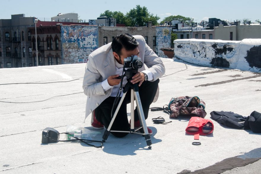 Shinobi No Kame BTS - Asian guy on a rooftop setting up a camera on a tripod