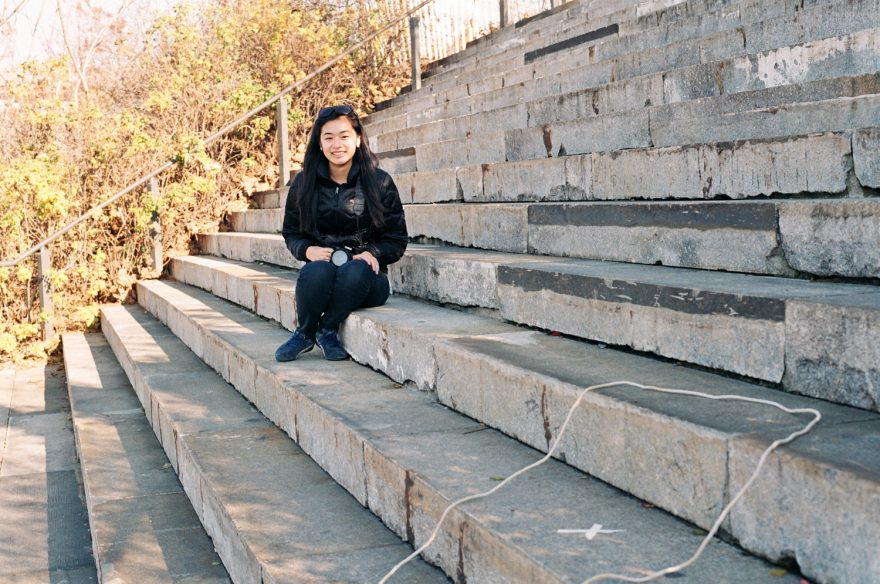 Asian women sitting on steps in brooklyn bridge park