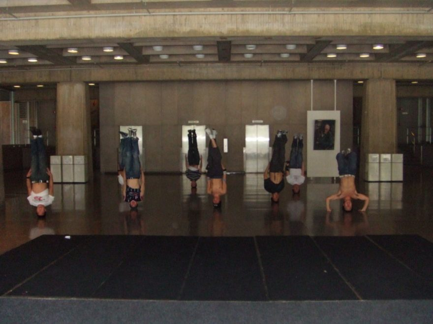 A group of Asian dancers doing a headstands at MIT.