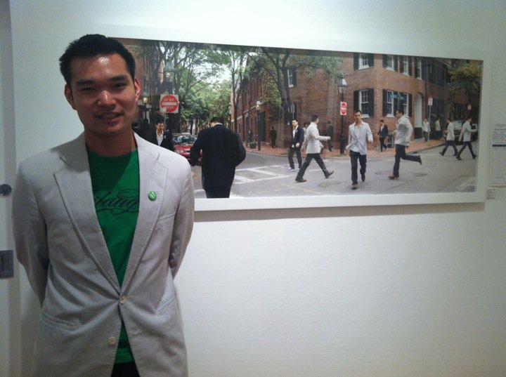 "Johnny Tang, standing in front of his piece ""Dichotomy"" at his first MassArt Auction in 2011."