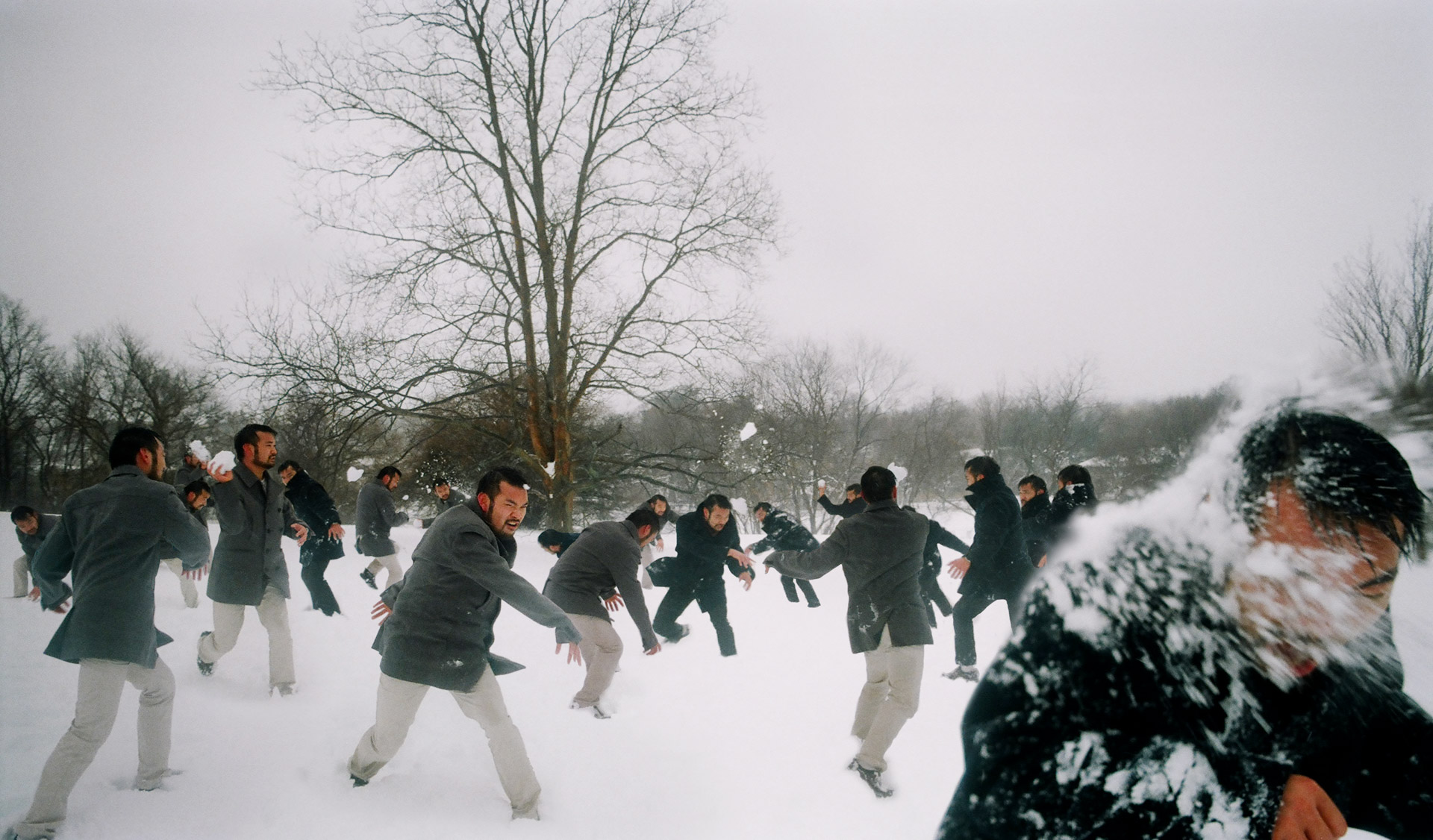 A guy having a snowball fight with himself