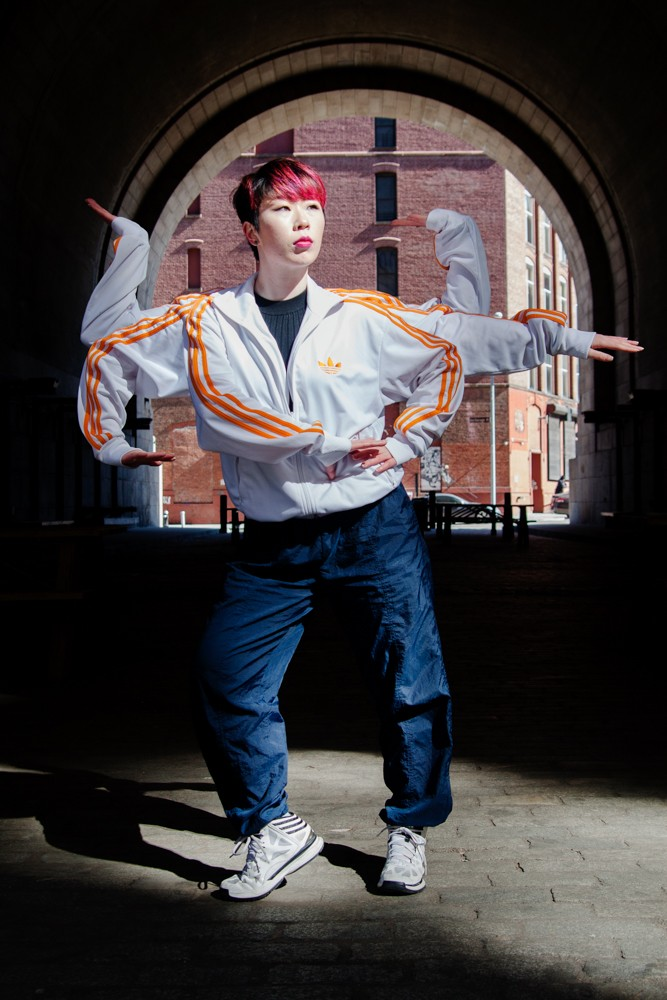 Popping Monster - Sun Buddha's Box. Sun Kim posing in DUMBO Brooklyn , tutting with 6 arms.