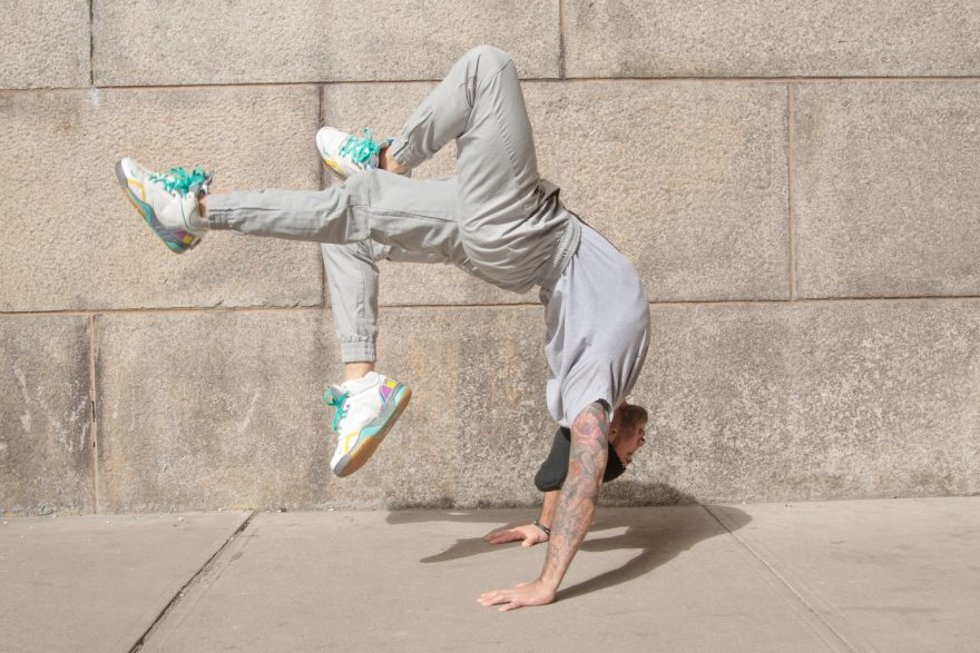 BBoy Monsters - Mike Fresh, Hallow Roots. BBoy Mike Fresh, doing hallowback poses on a sidewalk in Dumbo Brooklyn.