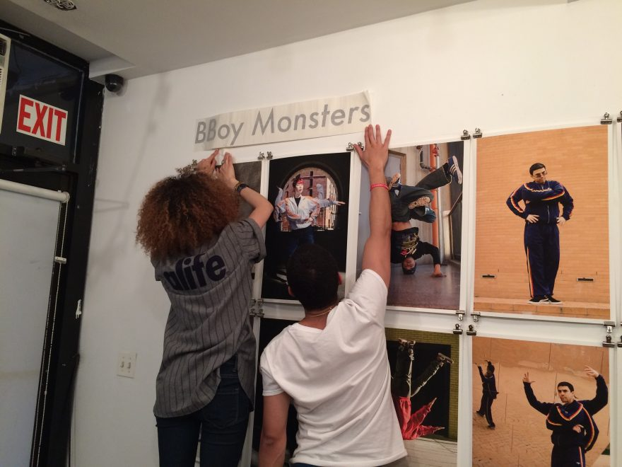 Putting up vinyl lettering for BBoy Monsters at Reedspace exhibition