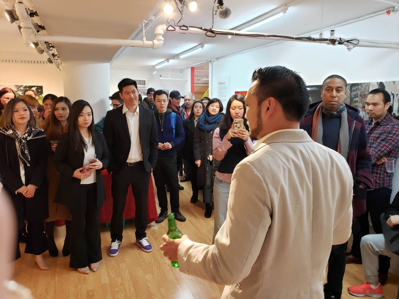 Johnny Tang addressing the crowd at the opening for his show at Pearl River Mart, March 23, 2019.